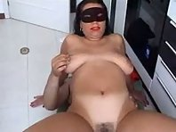 Blindfolded brunette sucking and receiving a massive cock