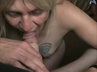 Sexy blonde sucking her husband's dick in POV and getting a cumshot on her tits