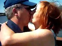 A red haired slut fucks two men outdoors